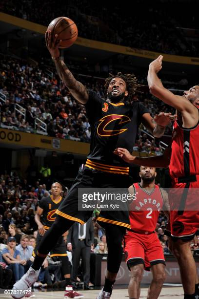 Derrick Williams of the Cleveland Cavaliers drives to the basket against the Toronto Raptors on April 12 2017 at Quicken Loans Arena in Cleveland...