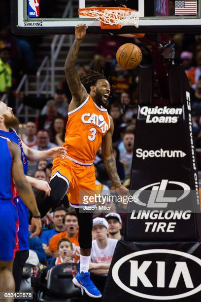 Derrick Williams of the Cleveland Cavaliers dunks during the first half against the Detroit Pistons at Quicken Loans Arena on March 14 2017 in...