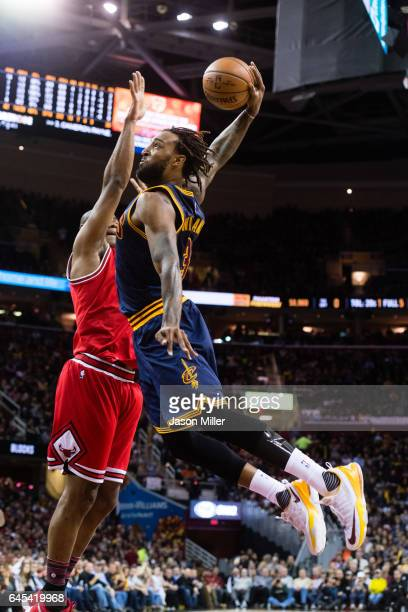 Derrick Williams of the Cleveland Cavaliers dunks over Cristiano Felicio of the Chicago Bulls during the first half at Quicken Loans Arena on...