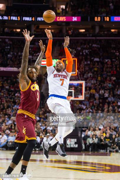 Derrick Williams of the Cleveland Cavaliers guards Carmelo Anthony of the New York Knicks during the first half at Quicken Loans Arena on February 23...