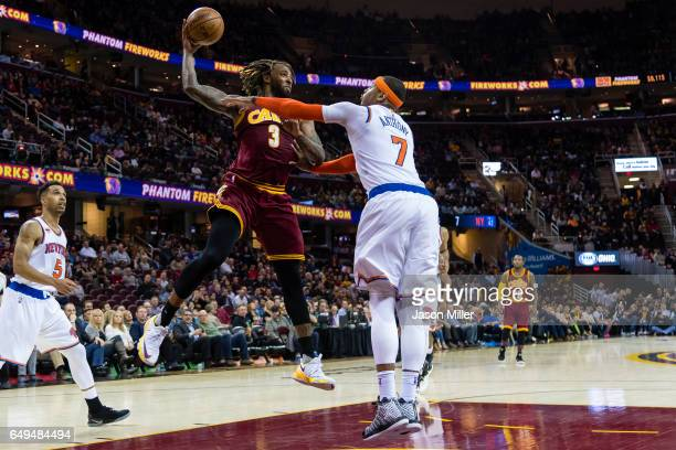 Derrick Williams of the Cleveland Cavaliers looks to pass over Carmelo Anthony of the New York Knicks during the second half at Quicken Loans Arena...