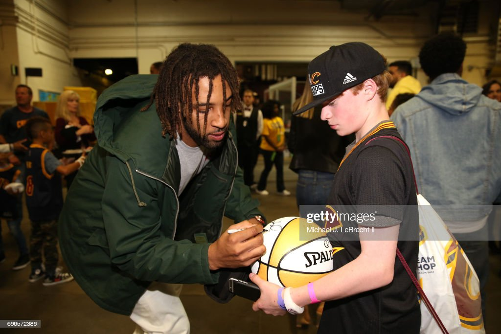 Derrick Williams #3 of the Cleveland Cavaliers signs autographs after the game against the Golden State Warriors in Game Four of the 2017 NBA Finals on June 9, 2017 at Quicken Loans Arena in Cleveland, Ohio.