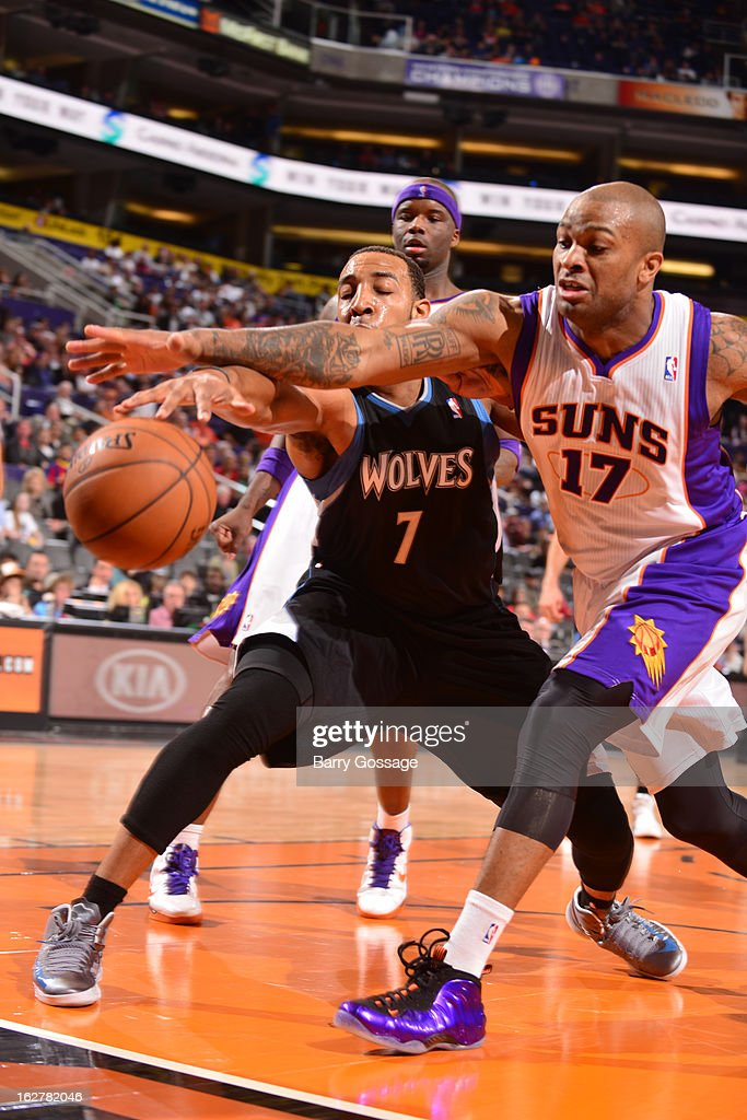 Derrick Williams #7 of the Minnesota Timberwolves and <a gi-track='captionPersonalityLinkClicked' href=/galleries/search?phrase=P.J.+Tucker&family=editorial&specificpeople=227316 ng-click='$event.stopPropagation()'>P.J. Tucker</a> #17 of the Phoenix Suns battle for a loose ball on February 26, 2013 at U.S. Airways Center in Phoenix, Arizona.