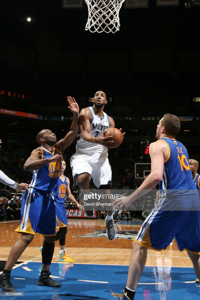 Derrick Williams #7 of the Minnesota Timberwolves drives to the basket against Carl Landry #7 of the Golden State Warriors on February 24, 2013 at Target Center in Minneapolis, Minnesota.