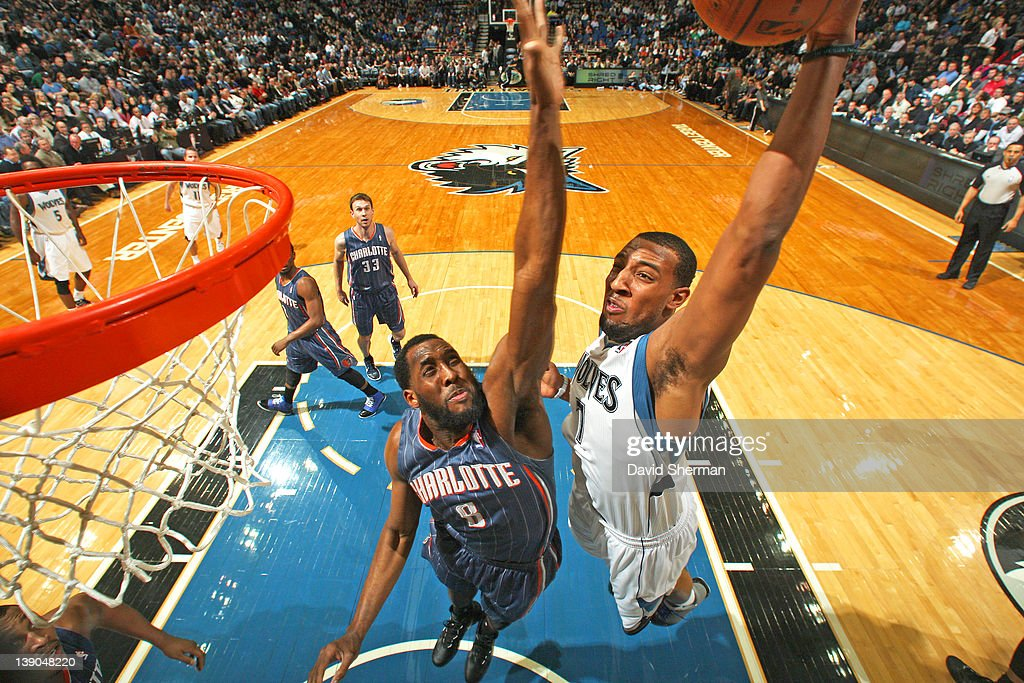 Derrick Williams #7 of the Minnesota Timberwolves goes in for a dunk against <a gi-track='captionPersonalityLinkClicked' href=/galleries/search?phrase=D.J.+White+-+Giocatore+di+basket&family=editorial&specificpeople=2537103 ng-click='$event.stopPropagation()'>D.J. White</a> #8 of the Charlotte Bobcats during the game on February 15, 2012 at Target Center in Minneapolis, Minnesota.