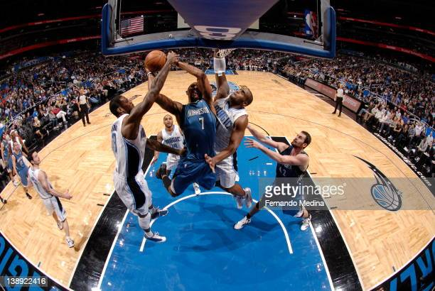 Derrick Williams of the Minnesota Timberwolves goes to the basket against Glen Davis and Earl Clark of the Orlando Magic during the game on February...