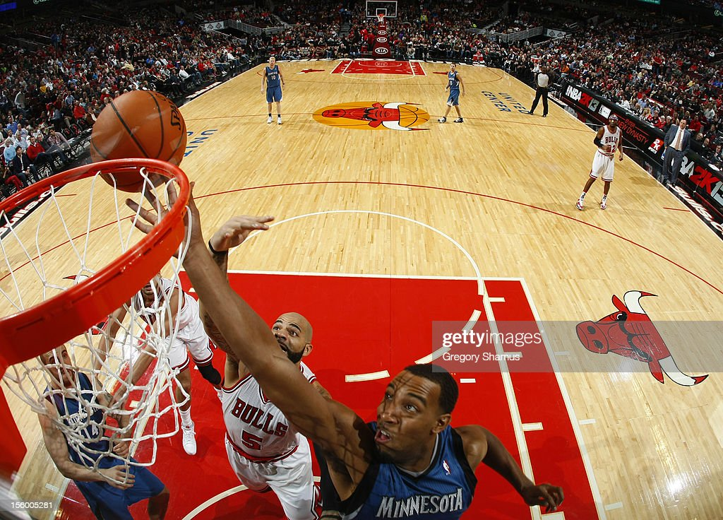 Derrick Williams #7 of the Minnesota Timberwolves goes to the basket over <a gi-track='captionPersonalityLinkClicked' href=/galleries/search?phrase=Carlos+Boozer&family=editorial&specificpeople=201638 ng-click='$event.stopPropagation()'>Carlos Boozer</a> #5 of the Chicago Bulls on November 10, 2012 at the United Center in Chicago, Illinois.