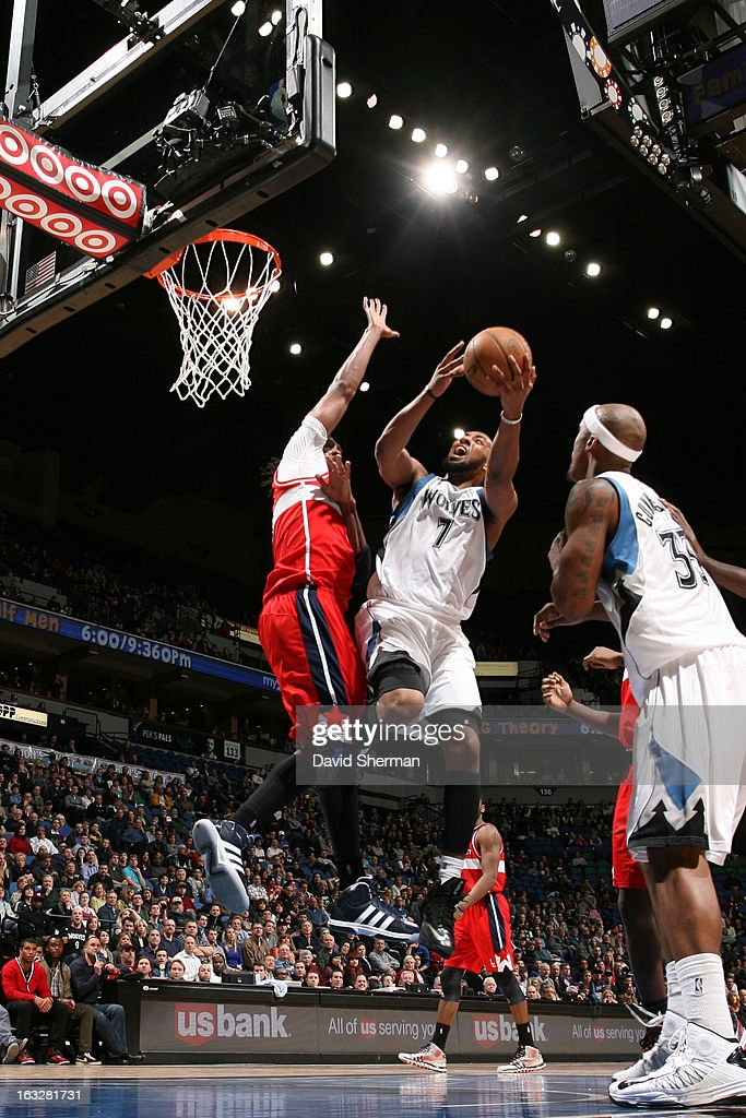 Derrick Williams #7 of the Minnesota Timberwolves goes to the basket against Nene #42 of the Washington Wizards on March 6, 2013 at Target Center in Minneapolis, Minnesota.