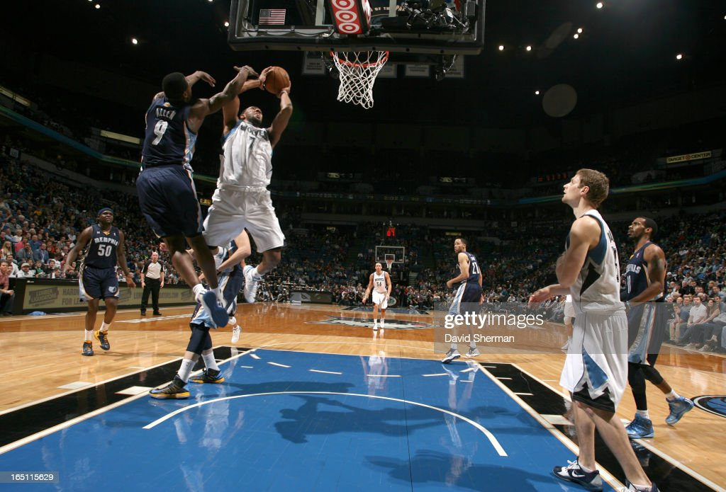 Derrick Williams #7 of the Minnesota Timberwolves goes to the basket against Tony Allen #9 of the Memphis Grizzlies during the game between the Memphis Grizzlies and the Minnesota Timberwolves on March 30, 2013 at Target Center in Minneapolis, Minnesota.