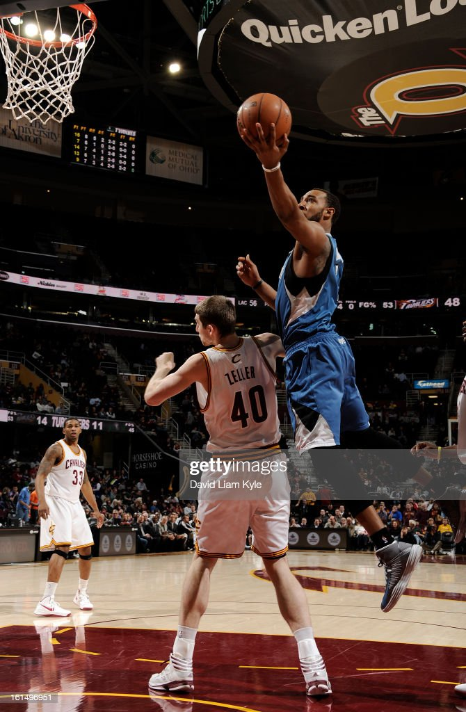 Derrick Williams #7 of the Minnesota Timberwolves goes up for a shot against <a gi-track='captionPersonalityLinkClicked' href=/galleries/search?phrase=Tyler+Zeller&family=editorial&specificpeople=5122156 ng-click='$event.stopPropagation()'>Tyler Zeller</a> #40 of the Cleveland Cavaliers at The Quicken Loans Arena on February 11, 2013 in Cleveland, Ohio.