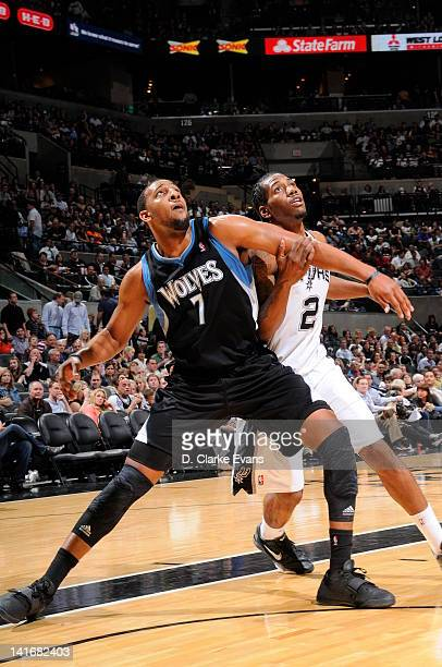 Derrick Williams of the Minnesota Timberwolves guards Kawhi Leonard of the San Antonio Spurs during the game between the Minnesota Timberwolves and...