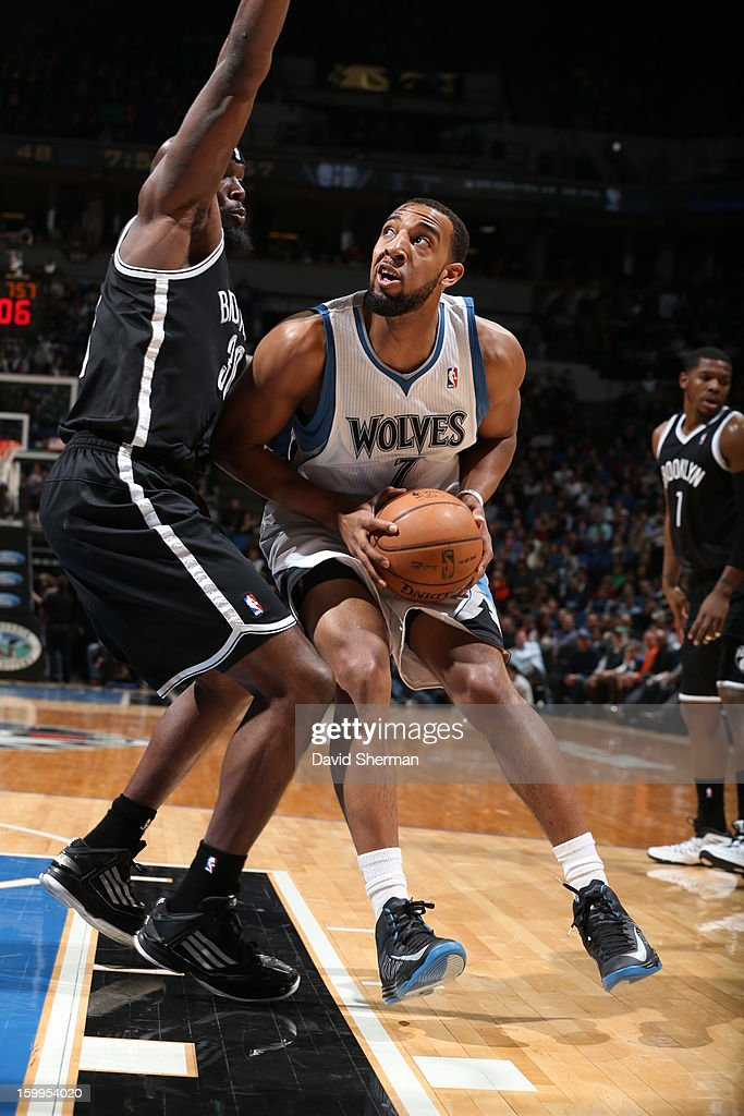 Derrick Williams #7 of the Minnesota Timberwolves protects the ball from Reggie Evans #30 of the Brooklyn Nets during the game between the Minnesota Timberwolves and the Brooklyn Nets on January 23, 2013 at Target Center in Minneapolis, Minnesota.