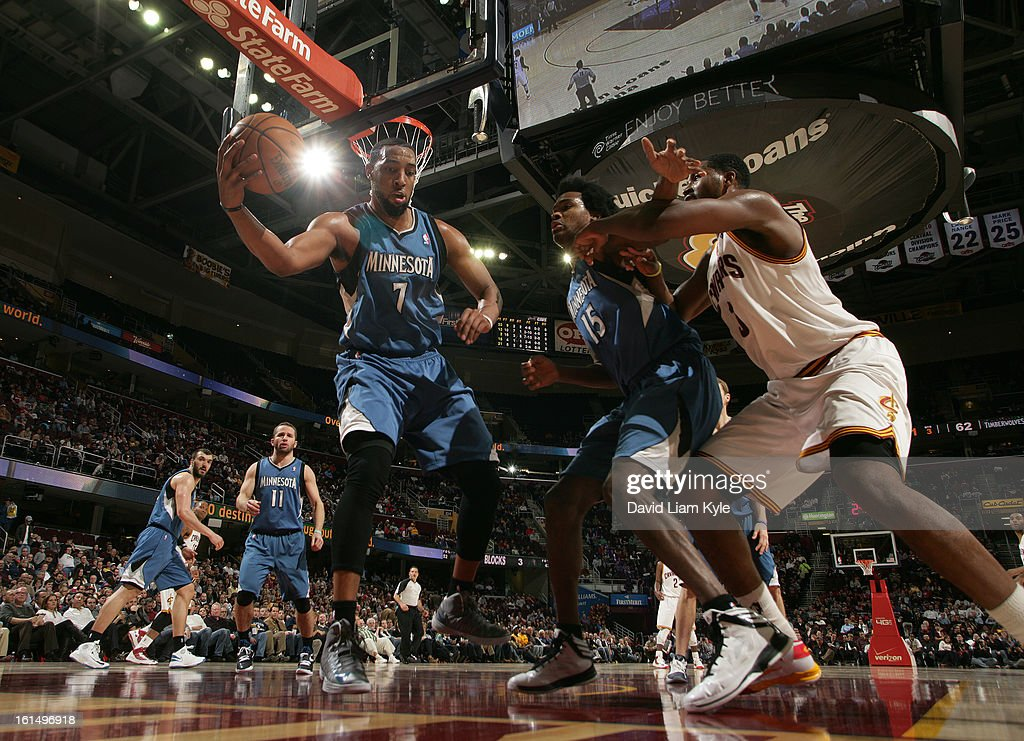 Derrick Williams #7 of the Minnesota Timberwolves saves the ball from going out of bounds alongside Mickael Gelabale #15 against Tristan Thompson #13 of the Cleveland Cavaliers at The Quicken Loans Arena on February 11, 2013 in Cleveland, Ohio.