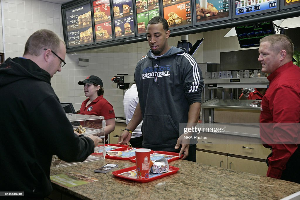 Derrick Williams of the Minnesota Timberwolves serve customers to raise money to benefit both the Arby's Foundation in support of Share our Strength's No Kid Hungry campaign and the Minnesota Timberwolves FastBreak Foundation on October 29, 2012 at the Arby's restaurant in St. Louis Park, Minnesota.