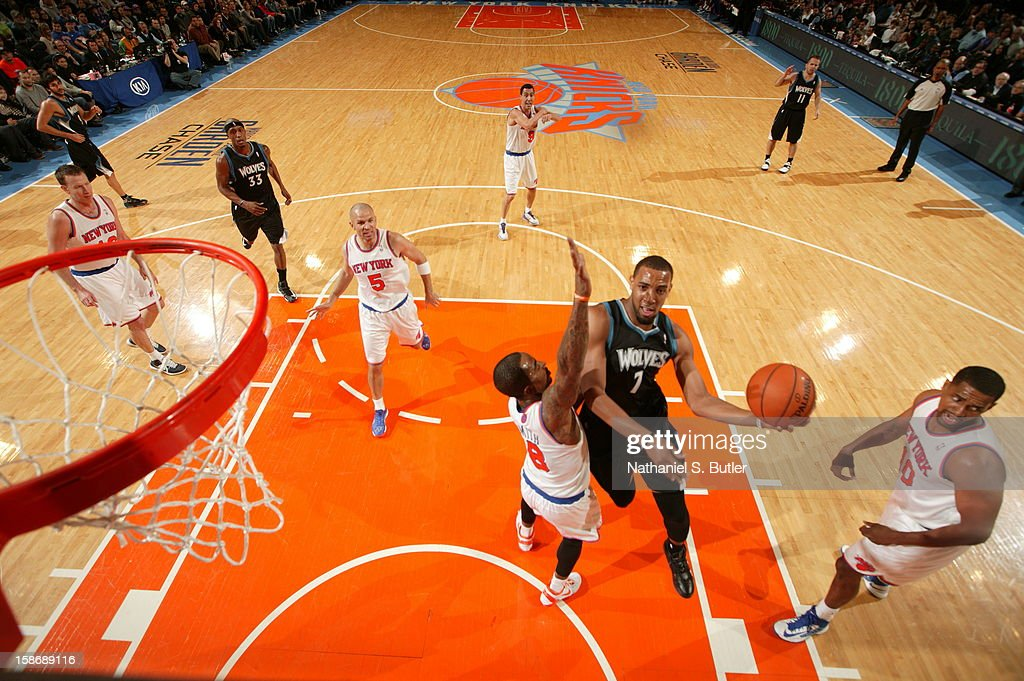 Derrick Williams #7 of the Minnesota Timberwolves shoots against <a gi-track='captionPersonalityLinkClicked' href=/galleries/search?phrase=J.R.+Smith&family=editorial&specificpeople=201766 ng-click='$event.stopPropagation()'>J.R. Smith</a> #8 of the New York Knicks on December 23, 2012 at Madison Square Garden in New York City.