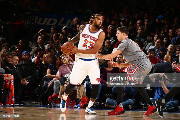 Derrick Williams of the New York Knicks defends the ball against the Chicago Bulls during the game on December 19 2015 at Madison Square Garden in...