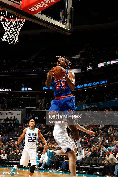 Derrick Williams of the New York Knicks drives to the basket against the Charlotte Hornets during a preseason game at the Time Warner Cable Arena on...