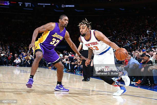 Derrick Williams of the New York Knicks drives to the basket against Metta World Peace of the Los Angeles Lakers during the game on November 8 2015...