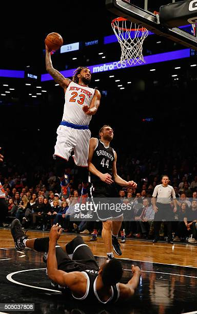 Derrick Williams of the New York Knicks dunks against the Brooklyn Nets during their game at the Barclays Center on January 13 2016 in New York City...