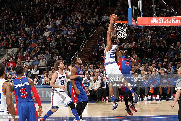 Derrick Williams of the New York Knicks dunks against the Detroit Pistons on December 29 2015 at Madison Square Garden in New York City New York NOTE...