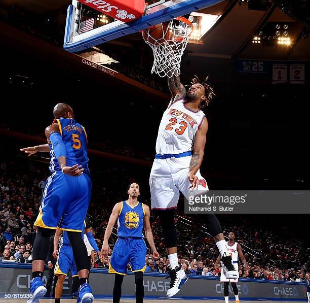 Derrick Williams of the New York Knicks dunks against the Golden State Warriors on January 31 2016 at Madison Square Garden in New York City NOTE TO...