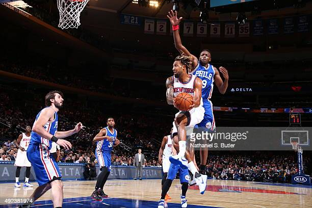 Derrick Williams of the New York Knicks goes to the basket against the Philadelphia 76ers on October 12 2015 at Madison Square Garden in New York...