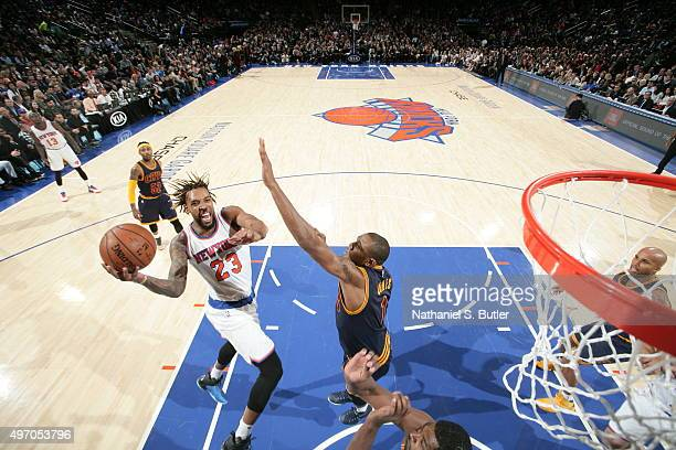 Derrick Williams of the New York Knicks goes to the basket against the Cleveland Cavaliers on November 13 2015 at Madison Square Garden in New York...