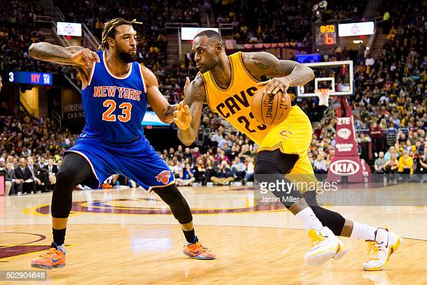Derrick Williams of the New York Knicks guards LeBron James of the Cleveland Cavaliers during the first half at Quicken Loans Arena on December 23...