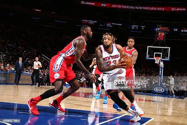 Derrick Williams of the New York Knicks handles the ball against the Philadelphia 76ers on December 2 2015 at Madison Square Garden in New York City...