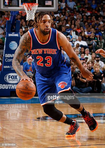 Derrick Williams of the New York Knicks handles the ball against the Dallas Mavericks on March 30 2016 at the American Airlines Center in Dallas...