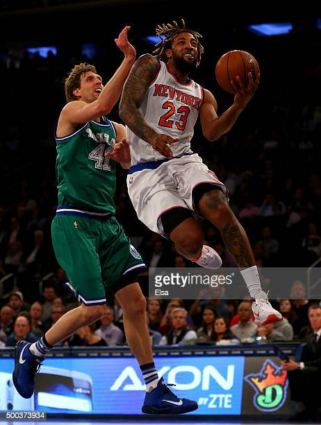 Derrick Williams of the New York Knicks heads for the net as Dirk Nowitzki of the Dallas Mavericks defends at Madison Square Garden on December 7...
