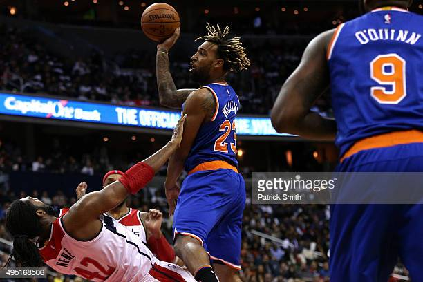 Derrick Williams of the New York Knicks shoots over Nene of the Washington Wizards during the first half at Verizon Center on October 31 2015 in...