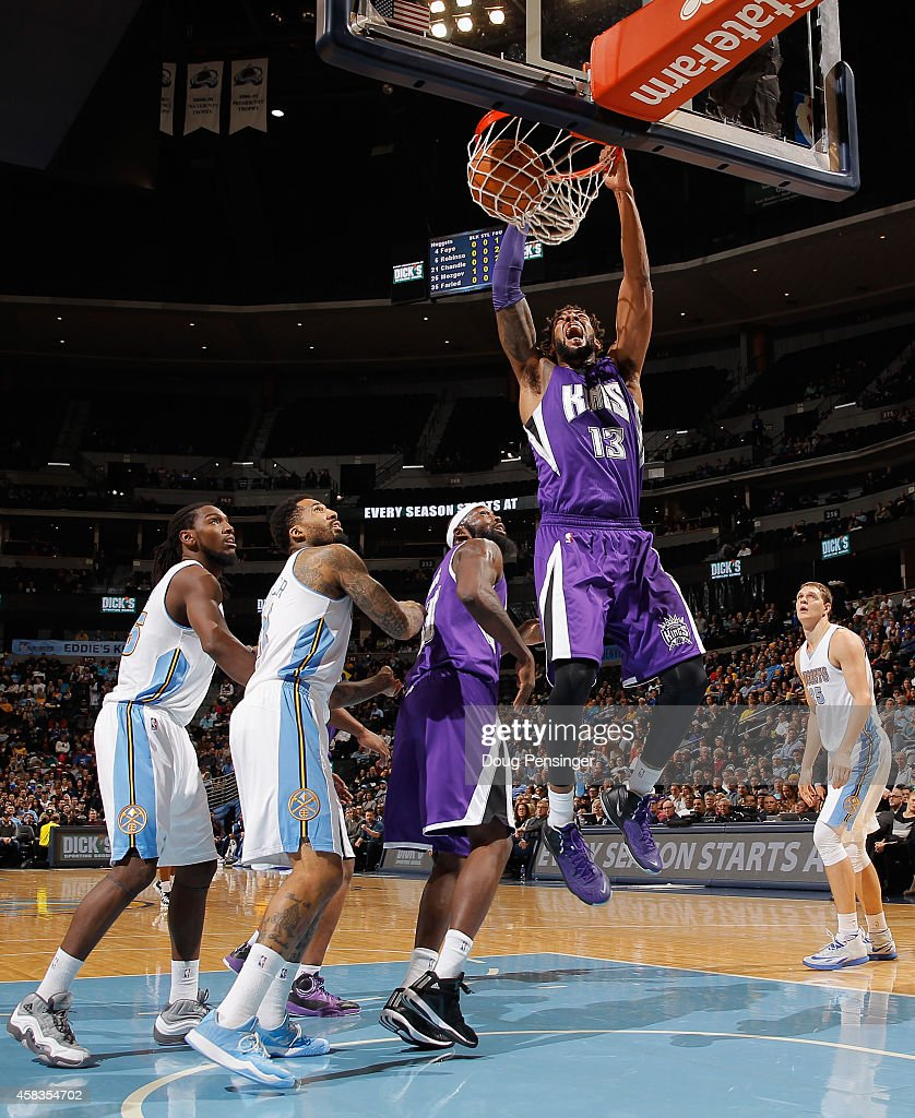 Derrick Williams of the Sacramento Kings dunks the ball against the Denver Nuggets at Pepsi Center on November 3 2014 in Denver Colorado NOTE TO USER...