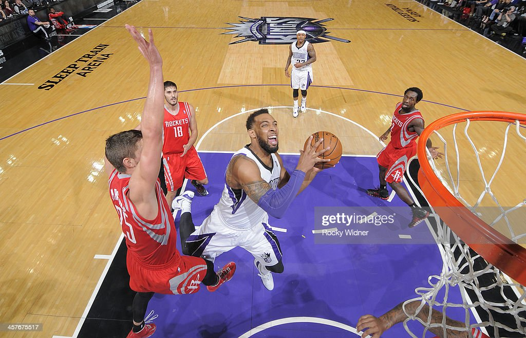 Derrick Williams #13 of the Sacramento Kings goes up for the shot against <a gi-track='captionPersonalityLinkClicked' href=/galleries/search?phrase=Chandler+Parsons&family=editorial&specificpeople=4249869 ng-click='$event.stopPropagation()'>Chandler Parsons</a> #25 of the Houston Rockets on December 15, 2013 at Sleep Train Arena in Sacramento, California.