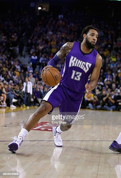 Derrick Williams of the Sacramento Kings in action against the Golden State Warriors at ORACLE Arena on December 22 2014 in Oakland California NOTE...
