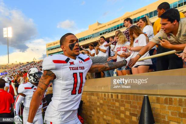Derrick Willies of the Texas Tech Red Raiders interacts with fans before the game between the Texas Tech Red Raiders and the Arizona State Sun Devils...