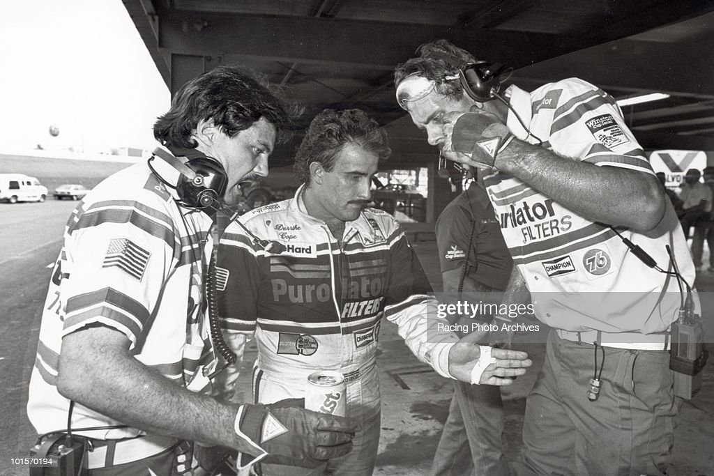 Derrike Cope explains to his crew how he spun out of control and ended his day. Cope would finish 29th and take home $735 for the day.