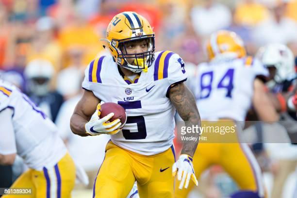 Derrius Guice of the LSU Tigers runs the ball during a game against the Auburn Tigers at Tiger Stadium on October 14 2017 in Baton Rouge Louisiana...