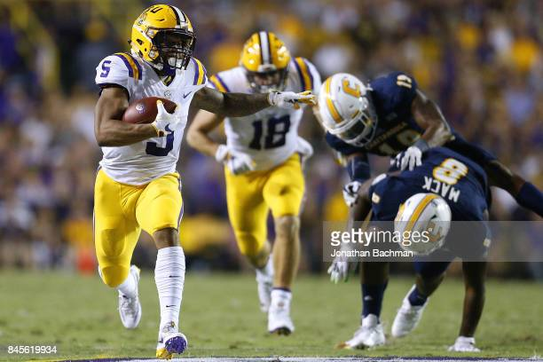 Derrius Guice of the LSU Tigers runs with the ball during a game against the Chattanooga Mocs at Tiger Stadium on September 9 2017 in Baton Rouge...
