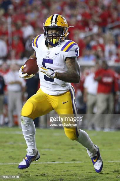 Derrius Guice of the LSU Tigers runs with the ball during a game against the Mississippi Rebels at VaughtHemingway Stadium on October 21 2017 in...