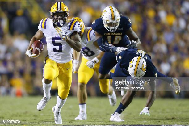 Derrius Guice of the LSU Tigers runs with the ball during the first half of a game against the Chattanooga Mocs at Tiger Stadium on September 9 2017...