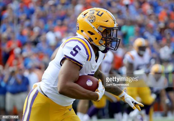 Derrius Guice of the LSU Tigers rushes for yardage during the game against the Florida Gators at Ben Hill Griffin Stadium on October 7 2017 in...