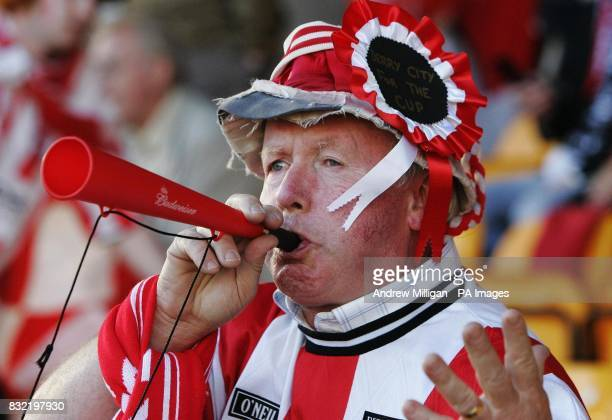 A Derry City fan celebrates following their 51 win over Gretna during the UEFA Cup second qualifying round first leg match at Fir Park Motherwell