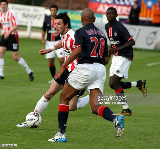 Derry City player Killian Brennan clashes with Paris Saint Germain's Paula Cesar during the UEFA Cup first round first leg match at the Brandywell...