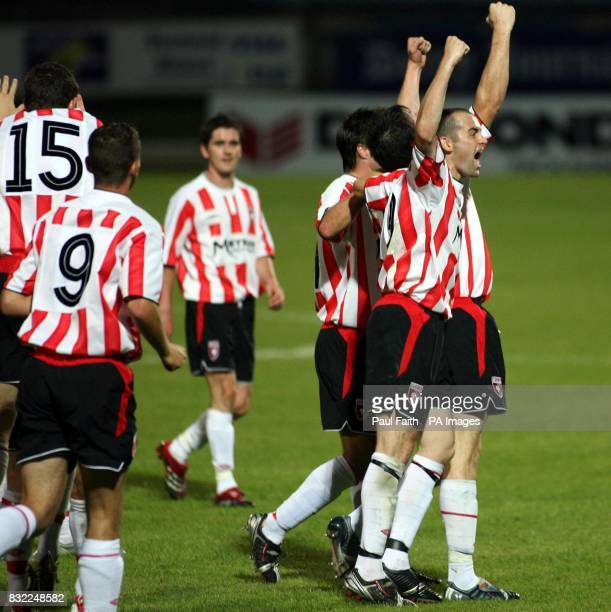 Derry City players celebrate after scoring their second goal against Gretna during the UEFA Cup second qualifying round second leg match at the...