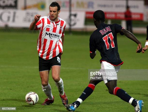 Derry City's Ciaran Martyn and Paris Saint Germain's Amara Diane during the UEFA Cup first round first leg match at the Brandywell Stadium Derry