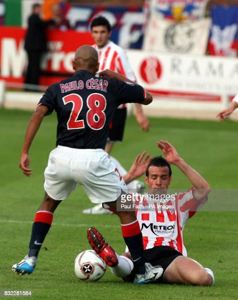 Derry City's Ciaran Martyn tackles Paris Saint Germain's Paula Cesar during the UEFA Cup first round first leg match at the Brandywell Stadium Derry