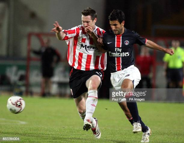 Derry City's Ken Oman and Paris Saint Germain's PierreAlain Frau during the UEFA Cup first round first leg match at the Brandywell Stadium Derry