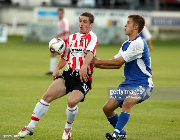 Derry City's Kevin McHugh keeps the ball from Gretna's Daniel Grainger during the UEFA Cup second qualifying round second leg match at the Brandywell...