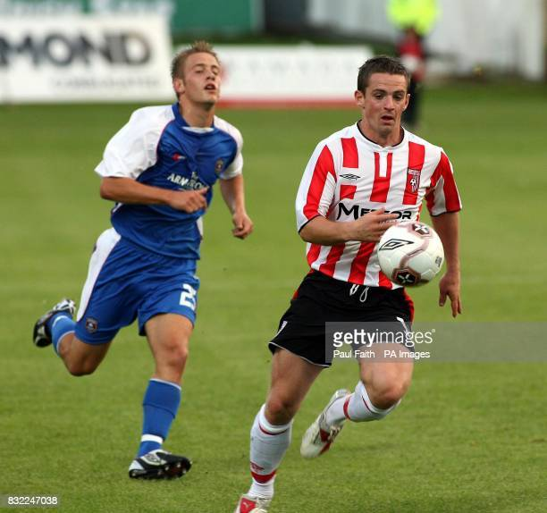 Derry City's Kevin McHugh takes the ball past Gretna's Derek Townsley during the UEFA Cup second qualifying round second leg match at the Brandywell...